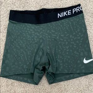 Green and black Nike pros